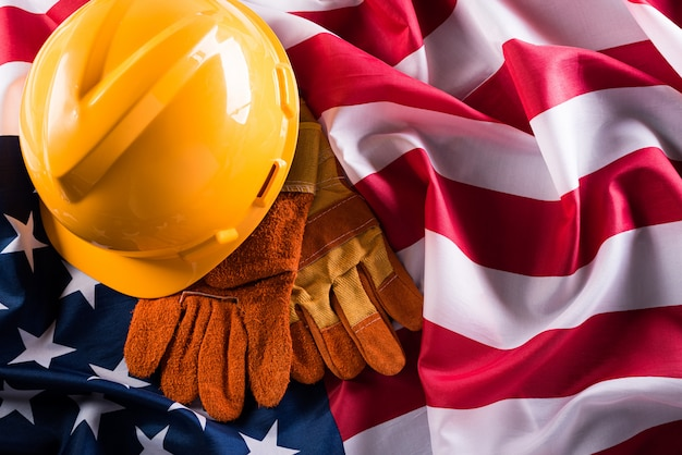 Happy labor day concept. american flag with different construction tools