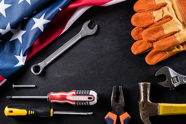Happy labor day concept on black table background, with copy space for text.
