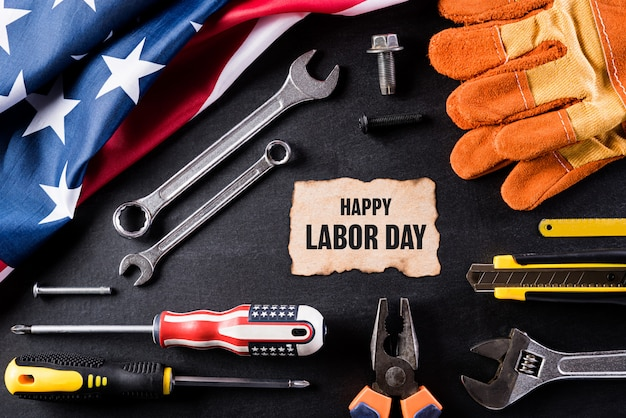 Happy labor day concept on black table background, with labor day text.