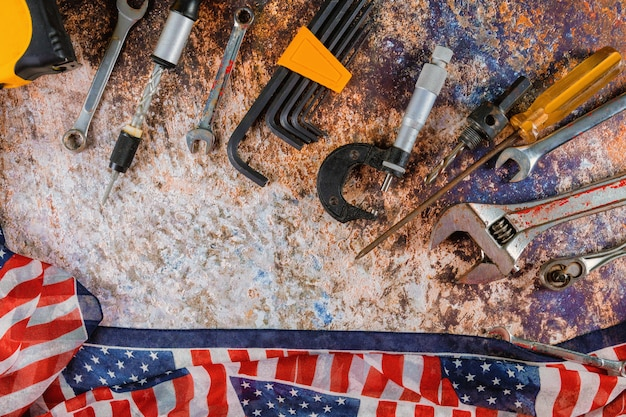 Happy labor day with american flag and construction tools
