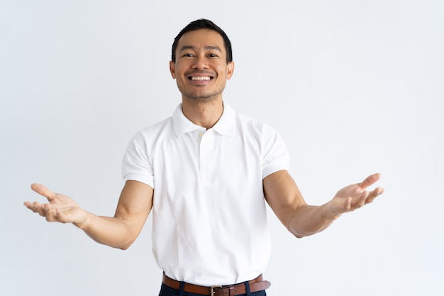 Happy latin guy outstretching hands and ready to hug