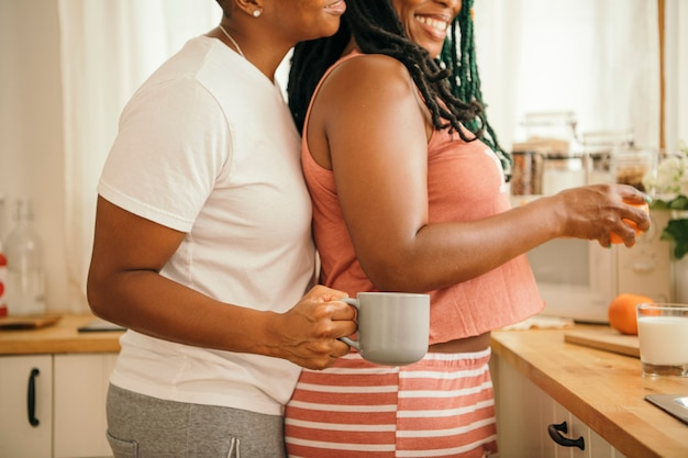Happy lesbian couple in the kitchen