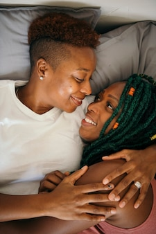 Happy lesbian lovers in bed