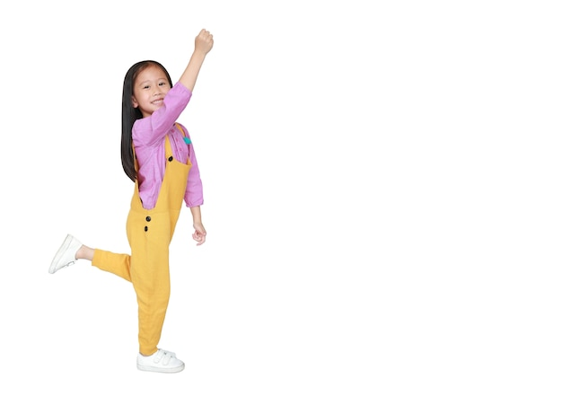 Happy little asian child girl in pink-yellow dungarees freedom movement
