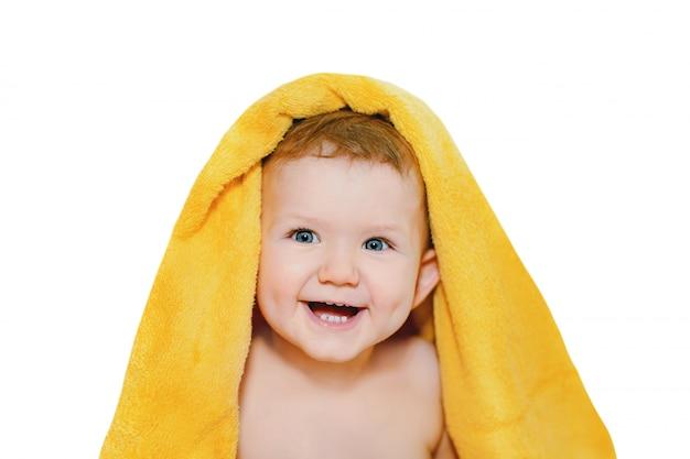 Happy little baby in yellow towel.