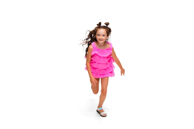 Happy little caucasian girl jumping and running isolated on white background