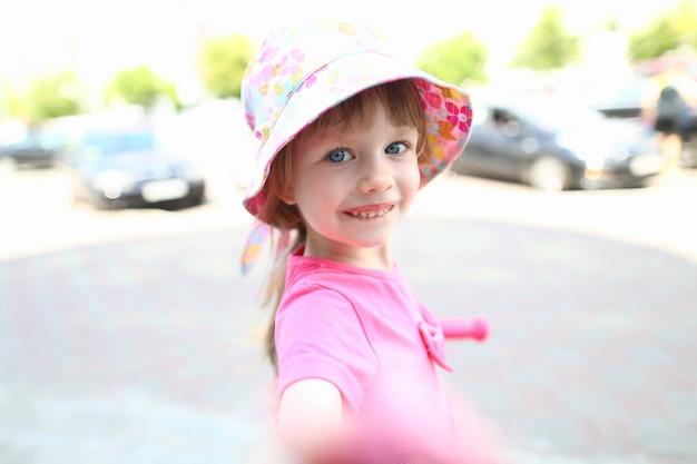 Happy little child make selfie smartphone outdoor
