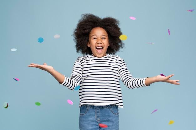 Happy little girl celebrating her birthday