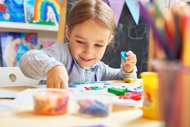 Happy little girl in development school