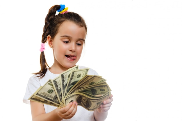 Happy little girl with money dollar isolated