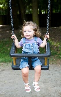 Happy little girls  on a swing