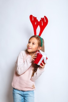Happy little smiling girl with christmas gift box.christmas concept.