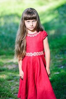 Happy little ukrainian girl in the national costume.