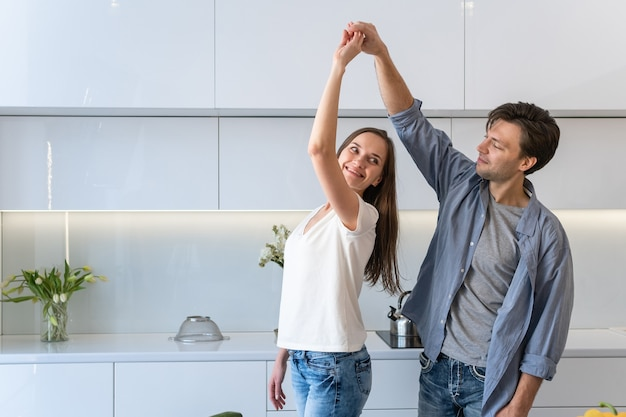 Happy loving couple dancing in the kitchen