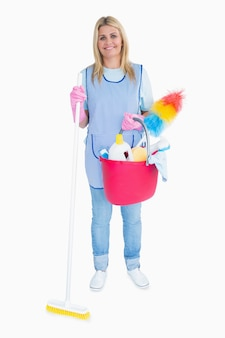 Happy maid holding a pink bucket