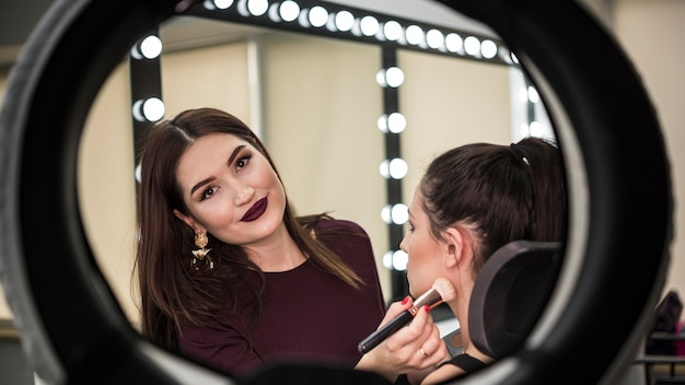 Happy make up artist in studio