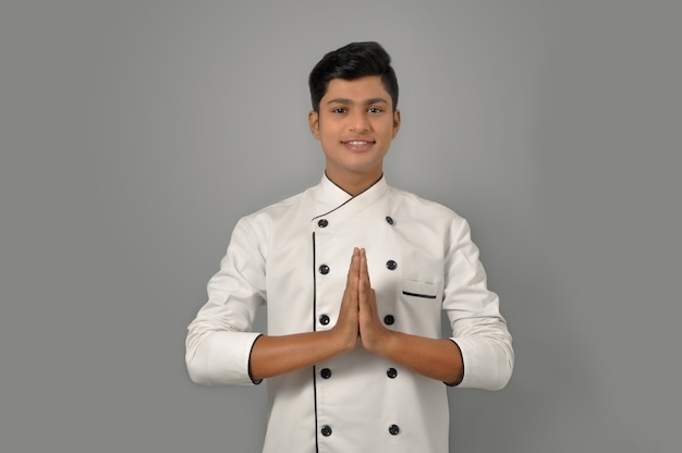 Happy male indian chef in a greeting pose