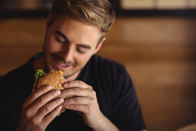Happy man eating burger