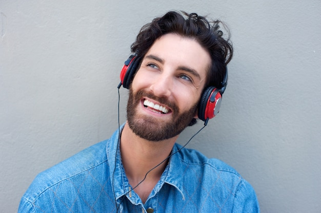 Happy man face smiling with headphones
