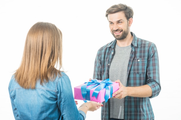 Happy man giving gift box to his girlfriend on white background