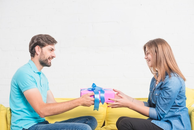 Happy man giving present to his lovely girlfriend