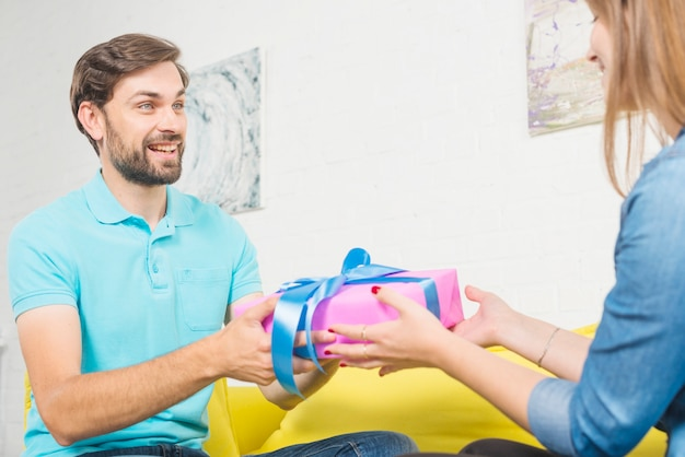 Happy man giving valentine gift to his wife