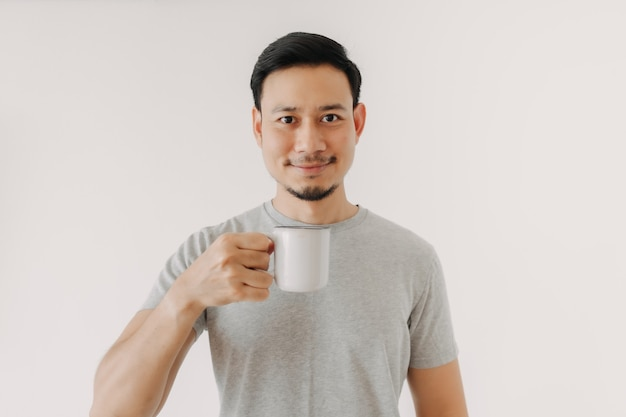 Happy man hold a cup of coffee isolated on white background