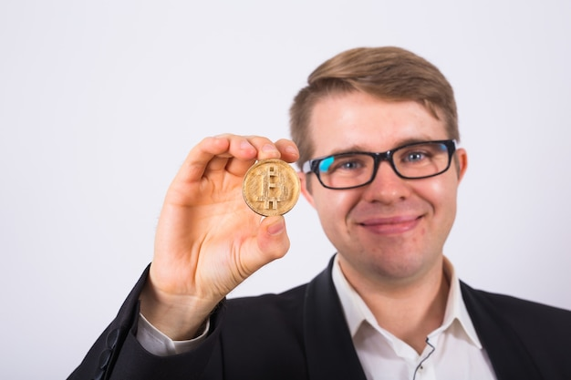 Happy man holding bitcoin on white background