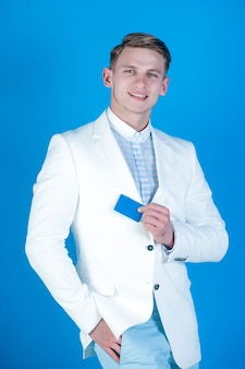 Happy man holding business or bank card