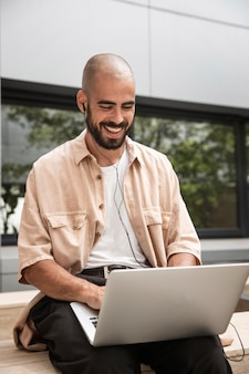 Happy man holding laptop