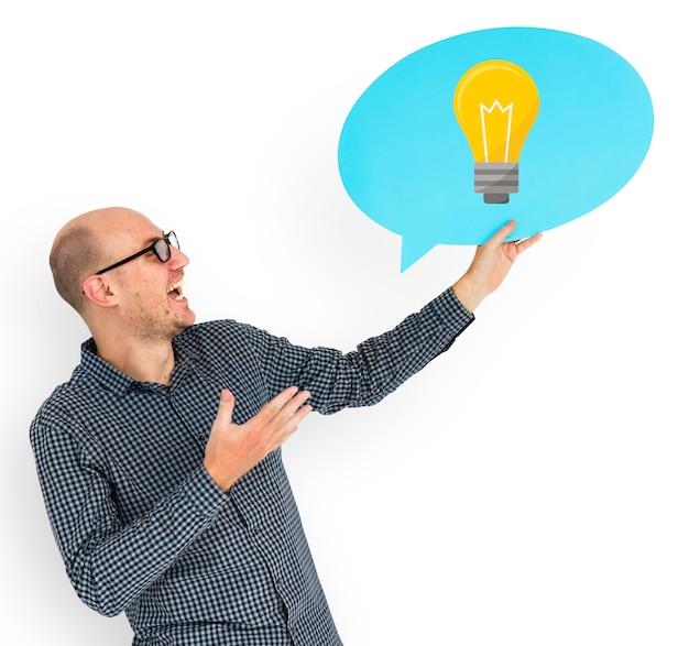 Happy man holding light bulb symbol
