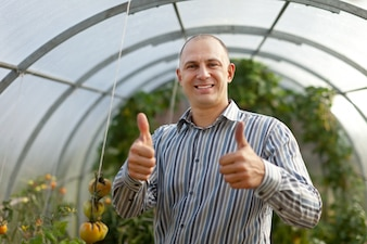 Happy man  in the hothouse