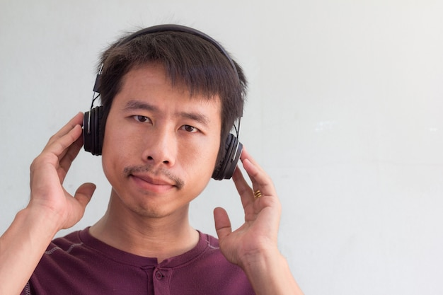 Happy man is listening to the music