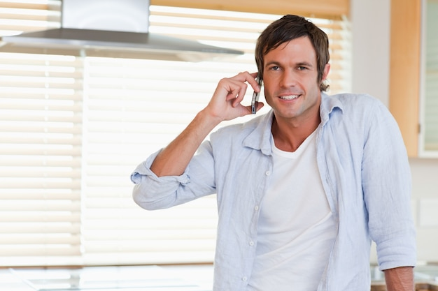Happy man making a phone call