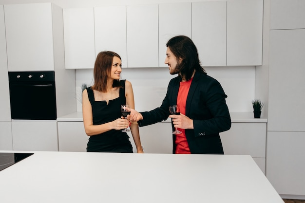 Happy man offering a glass of wine to his beloved woman