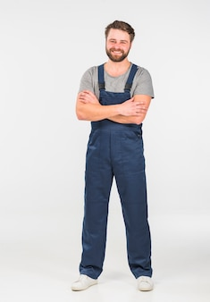 Happy man in overall with crossed arms