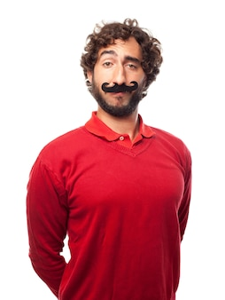 Happy man posing with a fake mustache