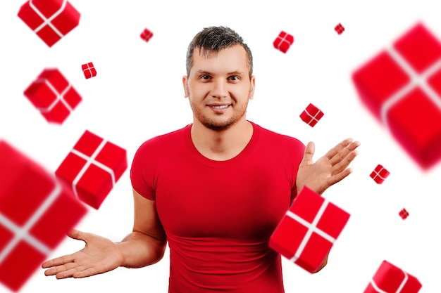 Happy man in red t-shirt is happy from gifts falling on white