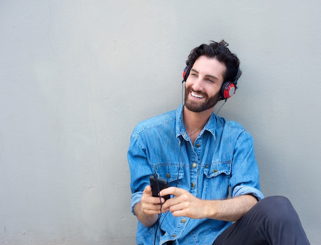 Happy man relaxing with mobile phone and headphones