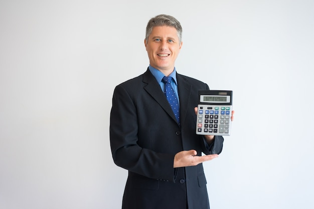 Happy man showing percentage rate on calculator