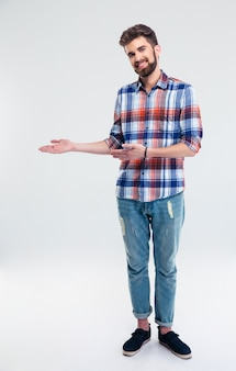 Happy man showing welcome gesture