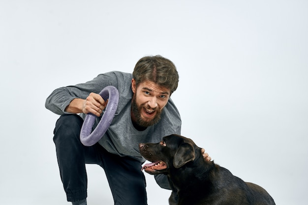 Happy man on sofa with his dog, isolation and quarantine with dog at home