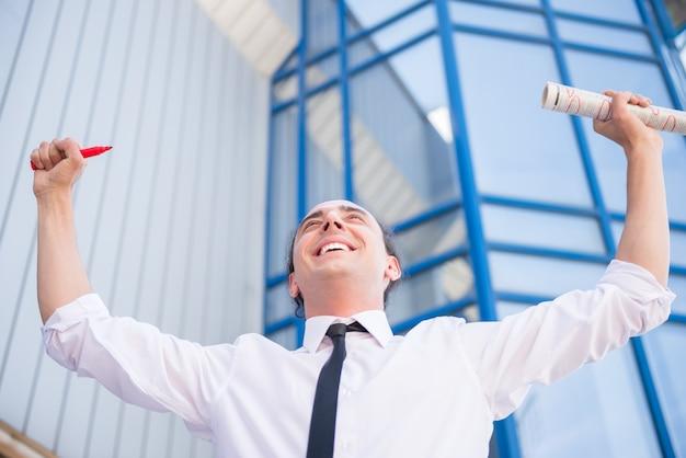 Happy man in suit is happy he found new job.