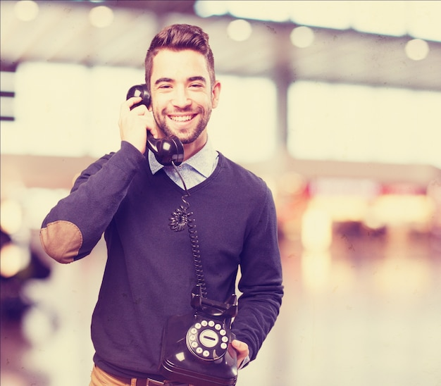 Happy man talking on an antique phone