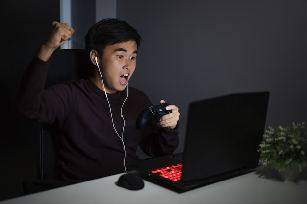 Happy man using joystick to playing games