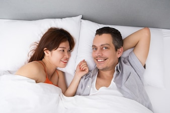 Happy man waking up with beloved wife