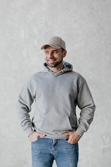 Happy man wearing a cap and a gray hoodie