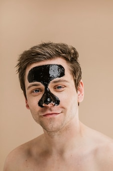 Happy man wearing a nose mask