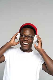 Happy man wears headphones enjoying listening to new album