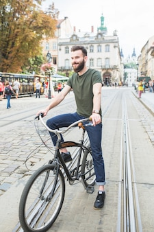 Happy man with bicycle in city